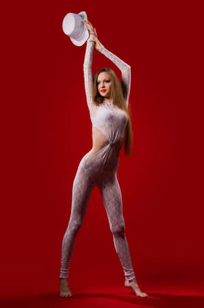beautiful young woman with a slender figure on a red background Stock Photo - 8966788
