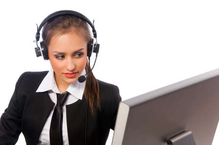 pretty girl with a headset works at the computer Standard-Bild