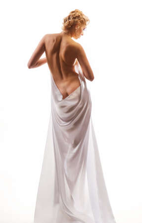 nude female figure: naked beautiful woman in a sheet on a white background Stock Photo