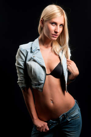 beautiful blonde in jeans on a black background Stock Photo - 9452048
