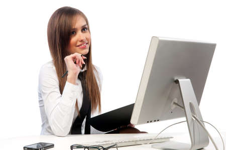 callcenter: pretty girl with a headset works at the computer Stock Photo
