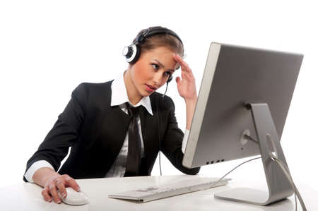 helpline: pretty girl with a headset works at the computer Stock Photo