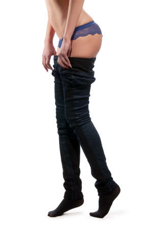 figure of a woman who takes off pants Stock Photo - 9926619