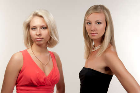 two beautiful women on a gray background Stock Photo - 9926696