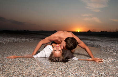 guy kiss his girlfriend on the beach Stock Photo - 10118659