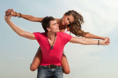 the guy holding the girlfriend on his back