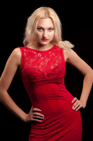 blonde woman in a red dress photo