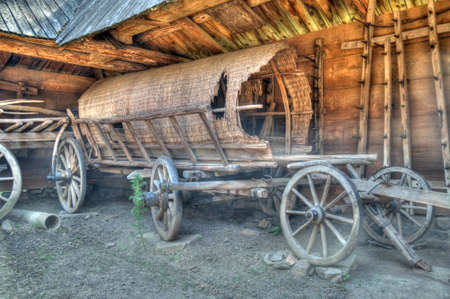 Old wooden coach wheels around a barn. Uzhgorod, Ukraine photo