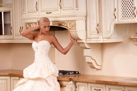 respectability: beautiful bride stands in the kitchen and laughs