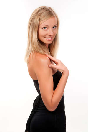 blonde girl in a dark dress on a light gray background Stock Photo - 10518758