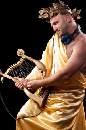 man with a harp and a wreath of the Greek god of clothing photo