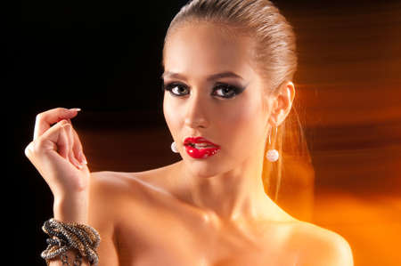 model nice: Beautiful woman with jewelry and colored lights Stock Photo