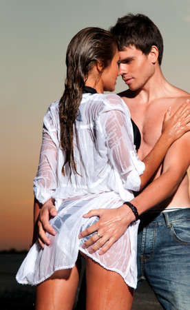 passionate couple: guy and his girlfriend are on the beach Stock Photo