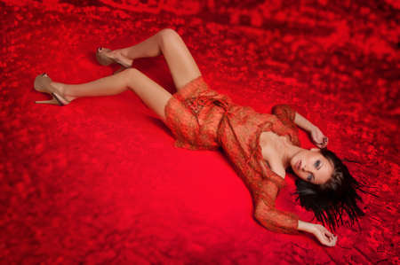 beautiful naked young woman on a red background Stock Photo - 10952089