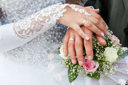 vows: Hand of the groom and the bride with wedding rings Stock Photo