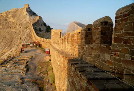 the ruins of an ancient fortress on a mountain in Crimea, Ukraine photo