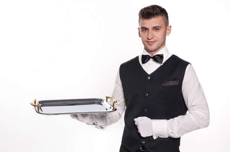 serve one person: Young person in a suit holding an empty tray isolated on white background