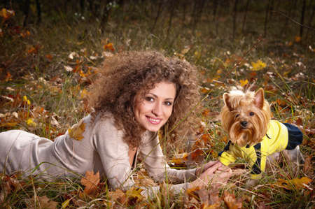Outdoors portrait beautiful woman with a dog in autumn Stock Photo - 11096804