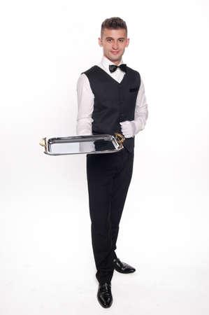trays: Jonge persoon in een pak bedrijf een lege lade geïsoleerd op witte achtergrond Stockfoto