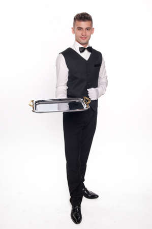 trays: Young person in a suit holding an empty tray isolated on white background