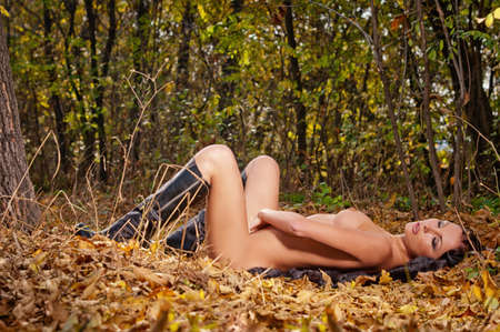 natural nude beauty posing outside in the nature photo