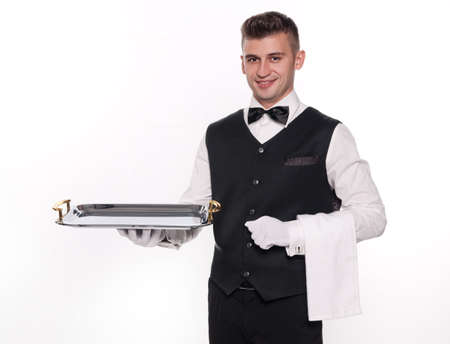silver tray: Young person in a suit holding an empty tray isolated on white background