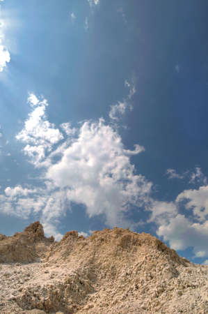 frontend: Clay pit in the background of a beautiful blue sky