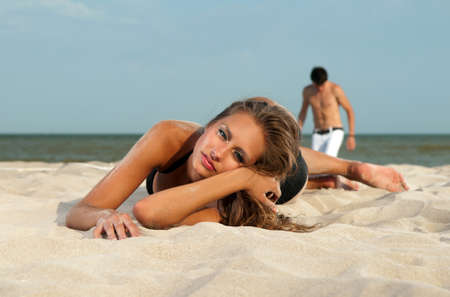 guy and his girlfriend are on the beach photo
