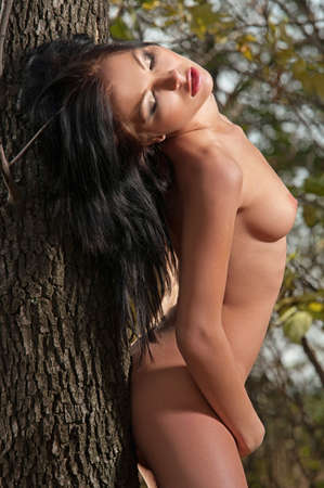 natural nude beauty posing outside in the nature in autumn Stock Photo