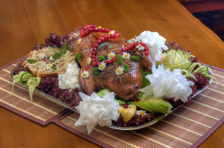 Dish with roast duck and vegetables on the table photo