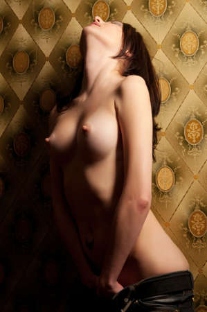 an attractive naked woman sitting on the couch