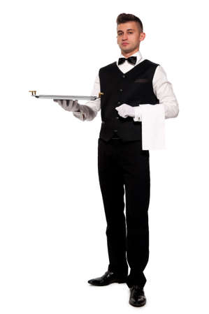 A young boy waiter with a tray. Isolated background and clipping path Archivio Fotografico