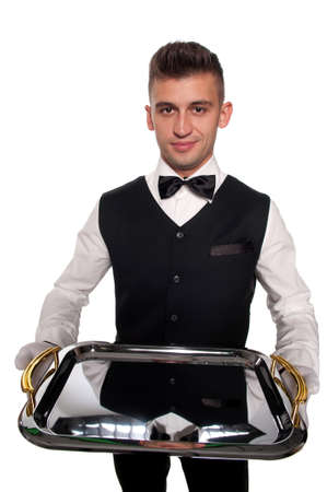 A young boy waiter with a tray. Isolated background and clipping path photo