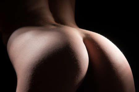 nude ass: Nude back and body on young female in soft light