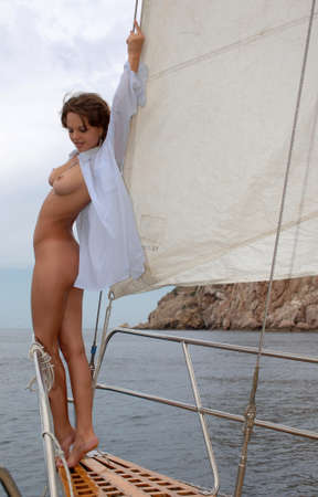 beach breast: young naked woman on a yacht
