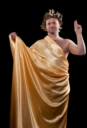 man dressed in Greek god. Black ground photo
