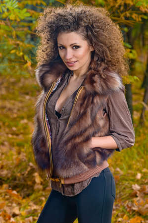 Outdoors portrait of beautiful colorful fall fashion woman Stock Photo - 11550510
