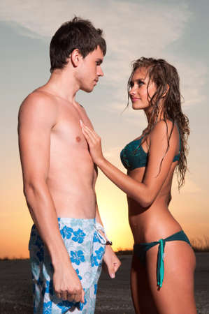 guy and his girlfriend are on the beach Stock Photo - 11784394