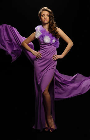 beautiful woman in the purple dress with a black background Stock Photo - 13054154
