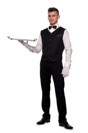 meseros: Un camarero joven con una bandeja aislada de fondo Foto de archivo