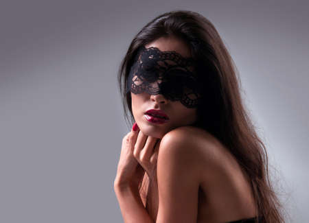 portrait of a girl in a mask with a gray background Stock Photo - 13428749