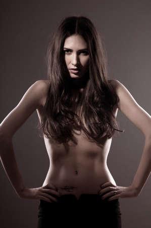 beautiful naked woman on a black background Stock Photo - 13428758