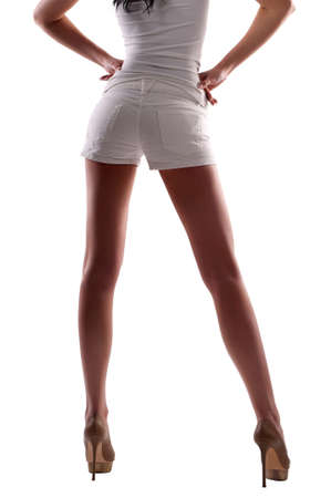 sexy stockings: a woman in shorts on an isolated background