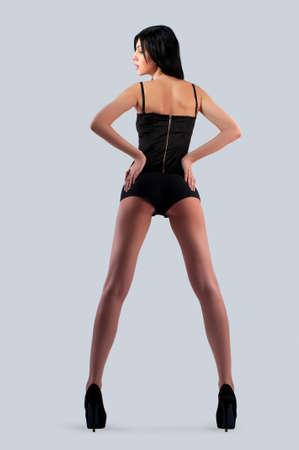 attractiveness: una mujer en pantalones cortos en un aislado fondo