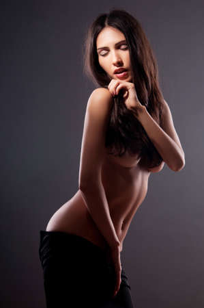 beautiful naked woman on a black background Stock Photo - 13447296