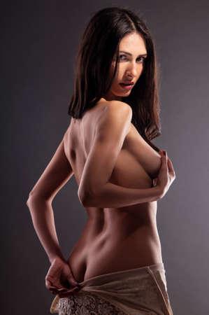 beautiful naked woman on a black background Stock Photo - 13447316