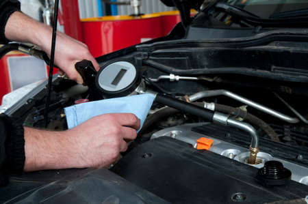 a man repairing a car engine  Close-up details Stock Photo - 13684356