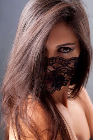 portrait of a girl in a mask with a gray background Stock Photo - 13702512