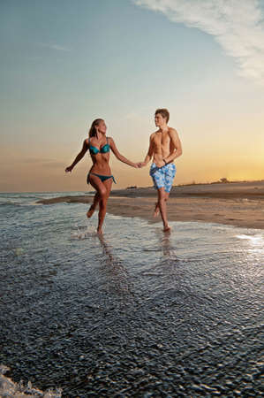 Romantic couple having fun on the seaside Stock Photo - 14114588