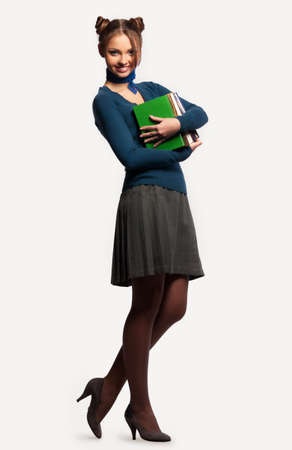 pretty girl with a bunch of books on an isolated background photo